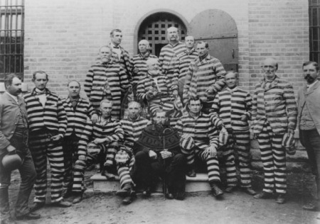"Polygamists in striped prison uniforms, including George Q. Cannon (center with cane). These men were also known as ""Prisoners of Conscience."""