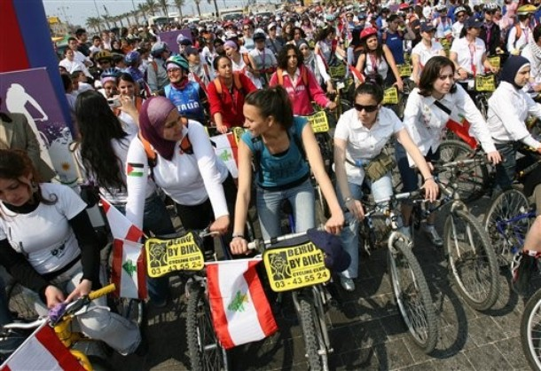 "Women activists wait at the starting line during the ""Follow the Women - Women for Peace"" ride in the southern port city of Sidon, Lebanon Tuesday, April 10, 2007. Some 350 women activists from 35 countries kicked off a 12-day bicycle ride Saturday in northern Syria and then transferred to Lebanon, to convey a message of peace and highlight the suffering of Arab women in the Middle East."