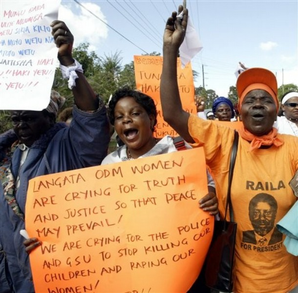 "Orange Democratic Movement women supporters carry posters and shout slogans against the government as they march to the city centre, Nairobi, Kenya, Thursday, Jan. 10, 2008. Kenyans mobilized Friday to demand the truth in their deadly dispute over presidential elections, with hundreds of women in the peace march yelling ""No peace, no justice!"" while civil rights groups presented police with a demand they prosecute electoral commissioners for allegedly falsifying the vote tally."
